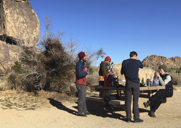 People visit Joshua Tree National Park in the southern California desert Thursday, Jan. 3, 2019.