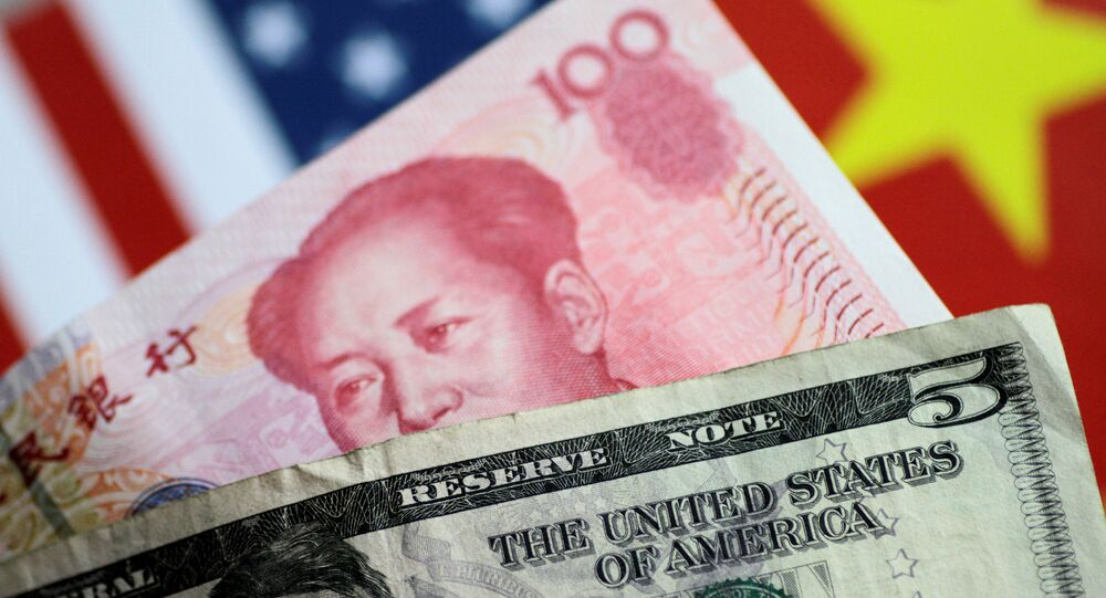 US Dollar and China Yuan notes are seen in this picture illustration June 2, 2017