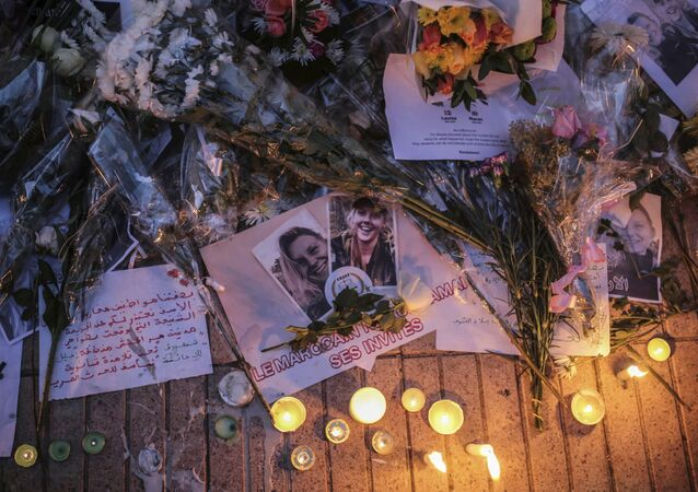Flowers, candles and messages are laid during a vigil outside the Norwegian embassy in Rabat for two Scandinavian university students who were killed in a terrorist attack in a remote area of the Atlas Mountains, Morocco, Saturday, Dec. 22, 2018
