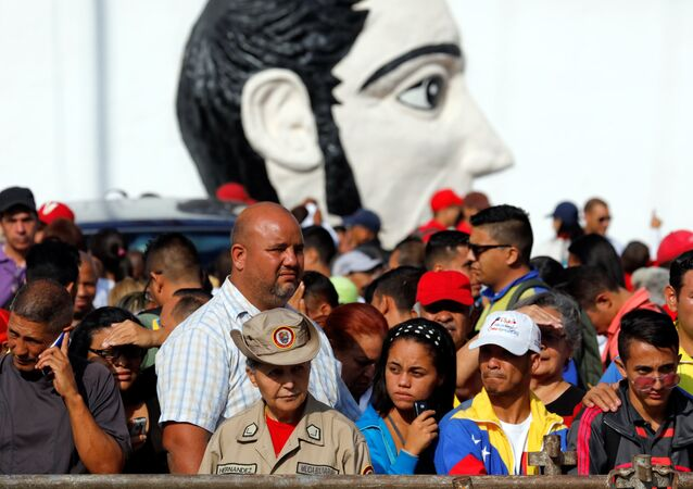 Supporters of Venezuela's President Nicolas Maduro gather around Supreme Court ahead of his swearing-in ceremony, in Caracas, Venezuela January 10, 2019.