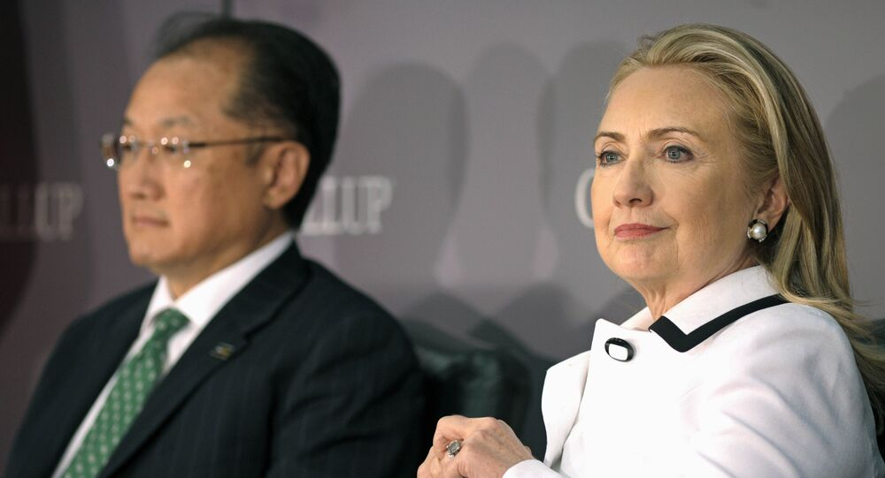 (File photo) World Bank President Jim Yong Kim, left, and Secretary of State Hillary Rodham Clinton wait to address the Gallup Evidence and Impact: Closing the Gender Data Gap conference in Washington, Thursday, July 19, 2012
