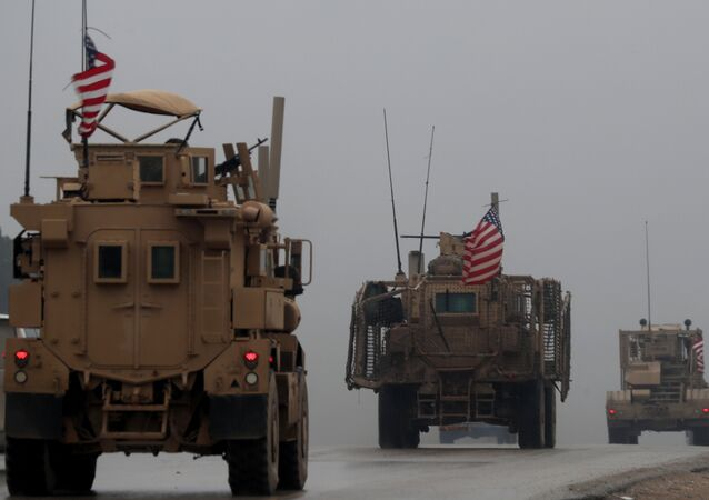 In this file photo taken on December 30, 2018, shows a line of US military vehicles in Syria's northern city of Manbij