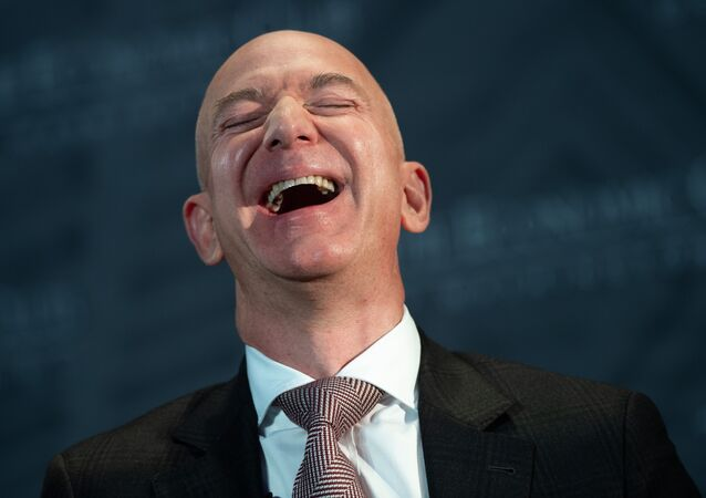 Jeff Bezos, founder and CEO of Amazon, laughs as he speaks during the Economic Club of Washington's Milestone Celebration event in Washington, DC, on September 13, 2018