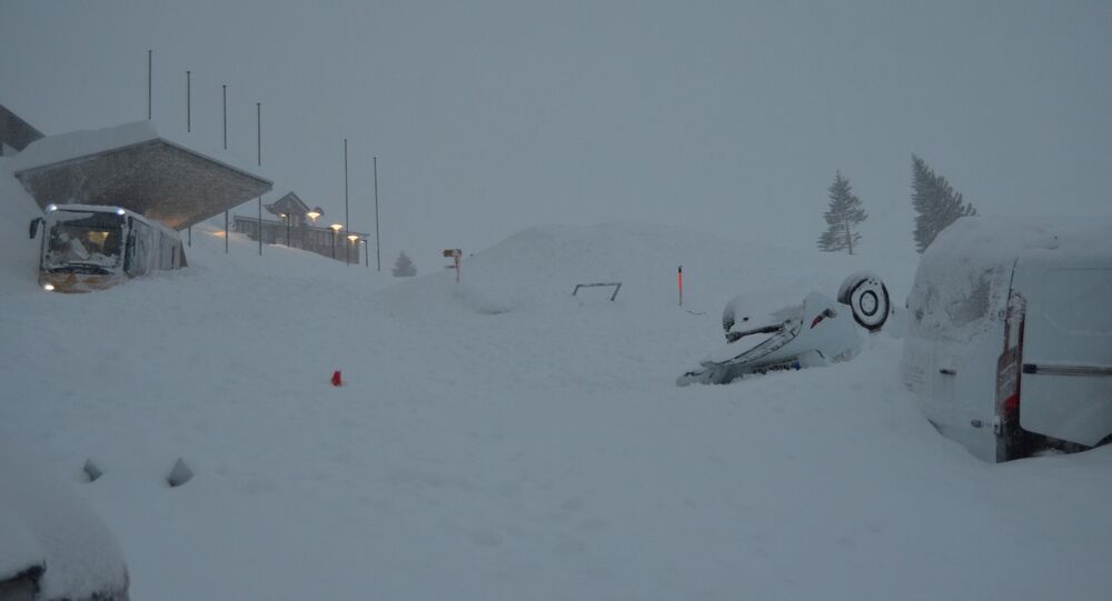 Snow covers vehicles at Santis-Schwaegalp mountain area after an avalanche, in Switzerland January 10, 2019