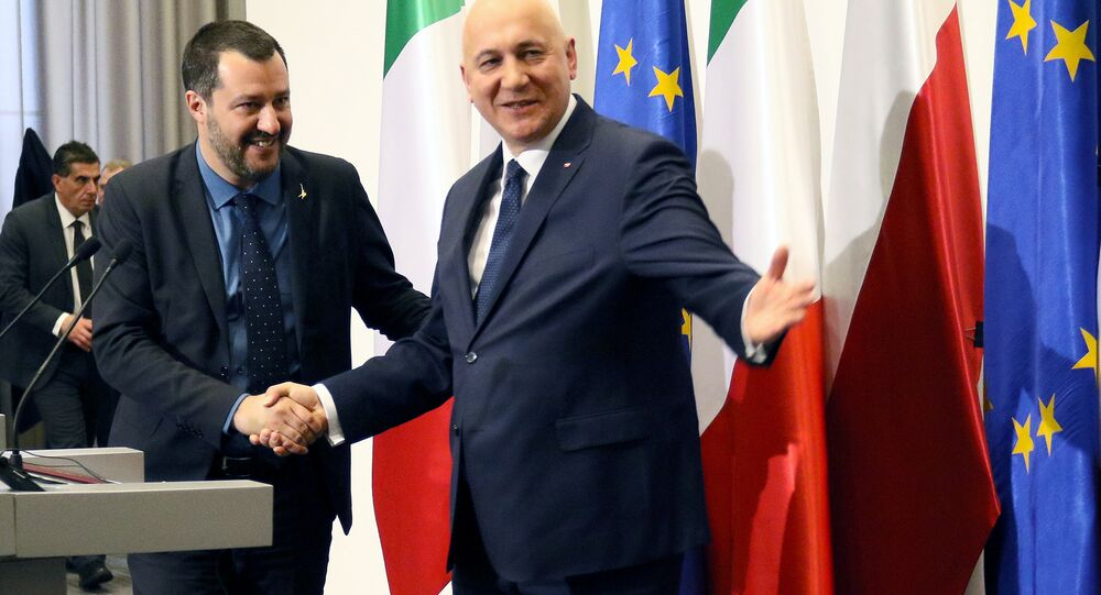 Italian Deputy Prime Minister Matteo Salvini shakes hands with Polish Interior Minister Joachim Brudzinski during a joint news conference in Warsaw, Poland January 9, 2019