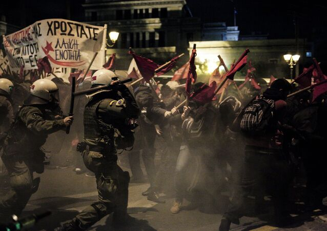 Protesters clash with police in Athens during Angela Merkel's visit to the country