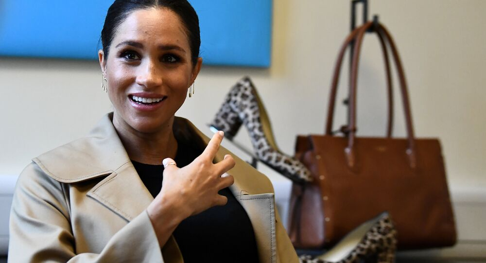Britain's Meghan, Duchess of Sussex gestures during her visit to Smart Works, a charity to which she has become patron, at St Charles hospital in west London on January 10, 2019.