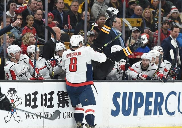 Alex Ovechkin launches Chara into Capitals bench with huge hit