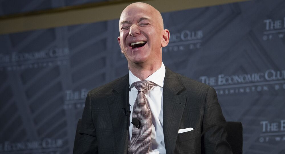 Jeff Bezos, Amazon founder and CEO, laughs as he speaks at The Economic Club of Washington's Milestone Celebration in Washington, Thursday, Sept. 13, 2018