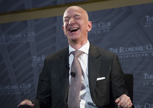 Jeff Bezos, Amazon founder and CEO, laughs as he speaks at The Economic Club of Washington's Milestone Celebration in Washington, Thursday, Sept. 13, 2018