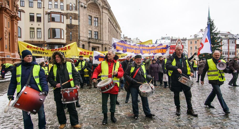 Almost 200 people joined a protest against social disparities in Latvia