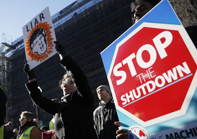 Union members and other federal employees rally to call for an end to the partial government shutdown, Thursday, Jan. 10, 2019 at AFL-CIO Headquarters in Washington