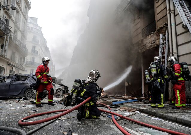 Firefighters extinguish a fire after the explosion of a bakery on the corner of the streets Saint-Cecile and Rue de Trevise in central Paris on January 12, 2019.