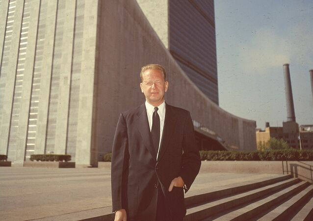 Secretary General of the United Nations Dag Hammarskjold poses outside the UN headquarters buildings in New York City in May 1956