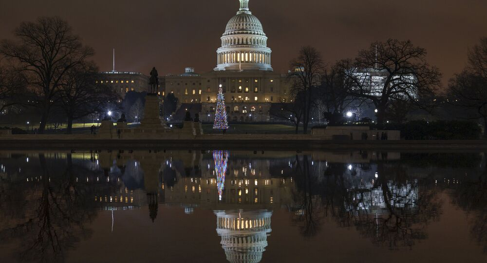 The US Capitol building is mirrored in the Reflecting Pool in Washington DC Dec. 28, 2018.