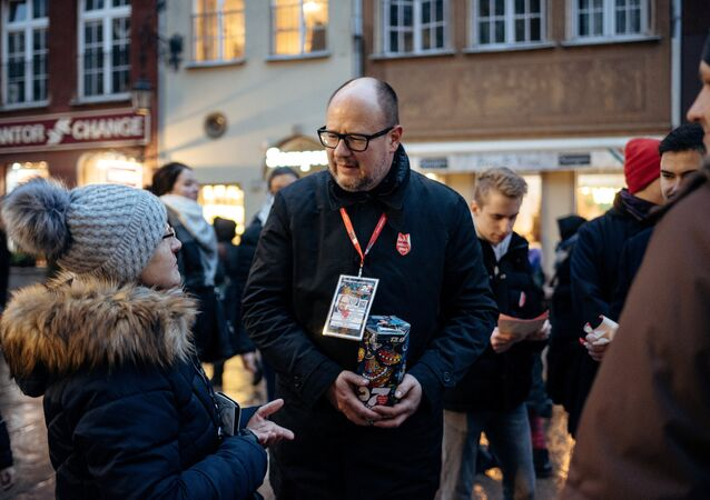 Gdansk's Mayor Pawel Adamowicz speaks with people as he collects money for the Great Orchestra of Christmas Charity in Gdansk, Poland January 13, 2019