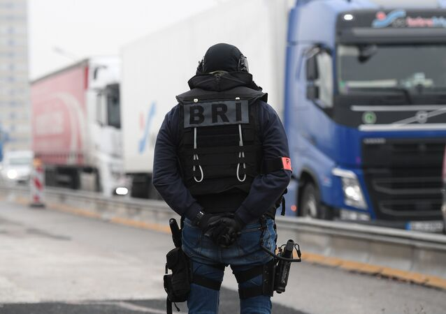 A member of the French police unit BRI (Research and Intervention Brigade - Brigades de recherche et d'intervention) stands guard at the border with Germany in Strasbourg, on December 12, 2018, as part of searches in order to find the gunman who opened fire near a Christmas market the night before, in Strasbourg, eastern France.