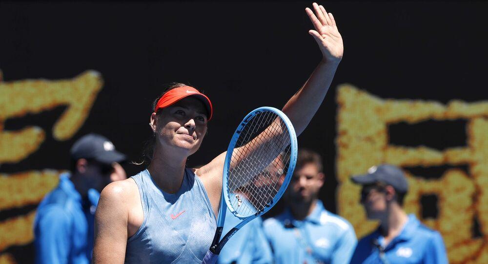 Tennis - Australian Open - First Round - Rod Laver Arena, Melbourne, Australia, January 14, 2019. Russia's Maria Sharapova waves to spectators at her match against Britain's Harriet Dart