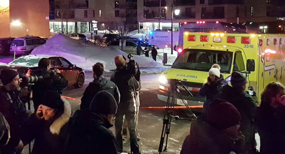 An ambulance is parked at the scene of a fatal shooting at the Quebec Islamic Cultural Centre in Quebec City, Canada
