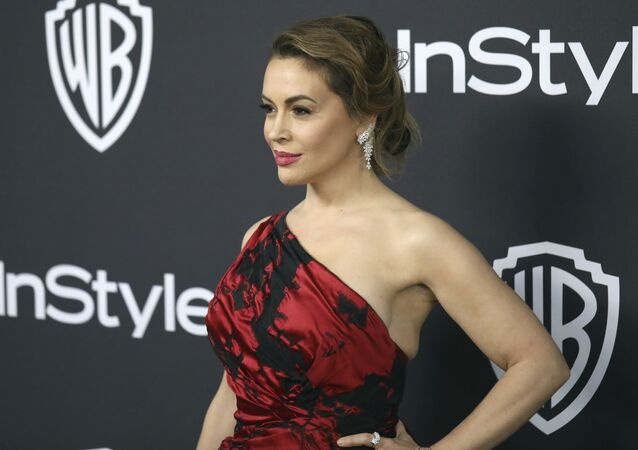 Alyssa Milano arrives at the InStyle and Warner Bros. Golden Globes afterparty at the Beverly Hilton Hotel on Sunday, Jan. 6, 2019, in Beverly Hills, Calif.