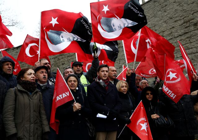Members of Vatan (Patriotic) Party wave Turkish and the party flags during a protest against U.S. President Donald Trump near the U.S. Consulate in Istanbul, Turkey January 15, 2019