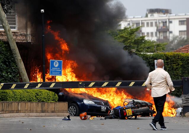 Cars are seen on fire at the scene where explosions and gunshots were heard at the Dusit hotel compound, in Nairobi, Kenya January 15, 2019
