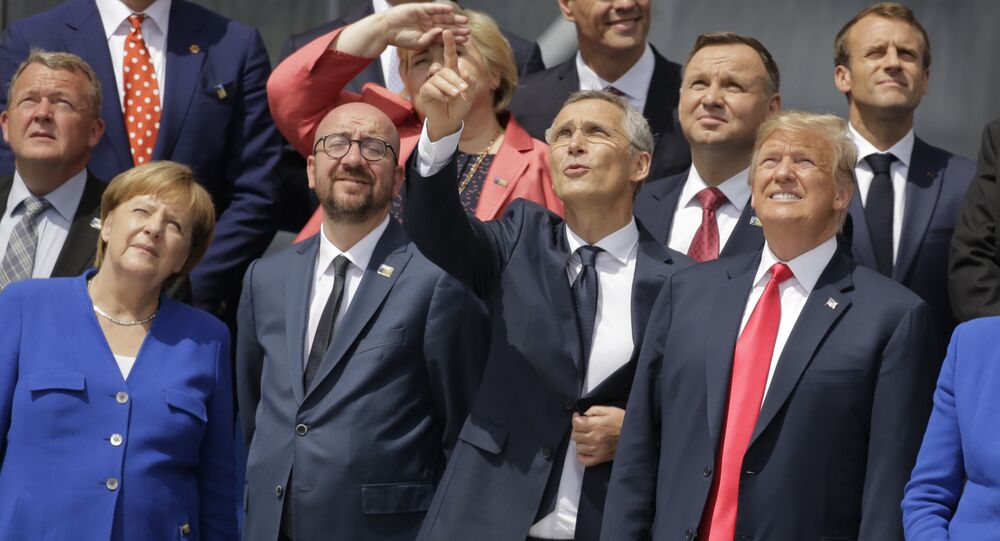 German Chancellor Angela Merkel, Belgian Prime Minister Charles Michel, NATO Secretary-General Jens Stoltenberg, U.S. President Donald Trump and British Prime Minister Theresa May, front row from left, watch a fly-by during a summit of heads of state and government at NATO headquarters in Brussels Wednesday, July 11, 2018. NATO leaders gather in Brussels for a two-day summit to discuss Russia, Iraq and their mission in Afghanistan.