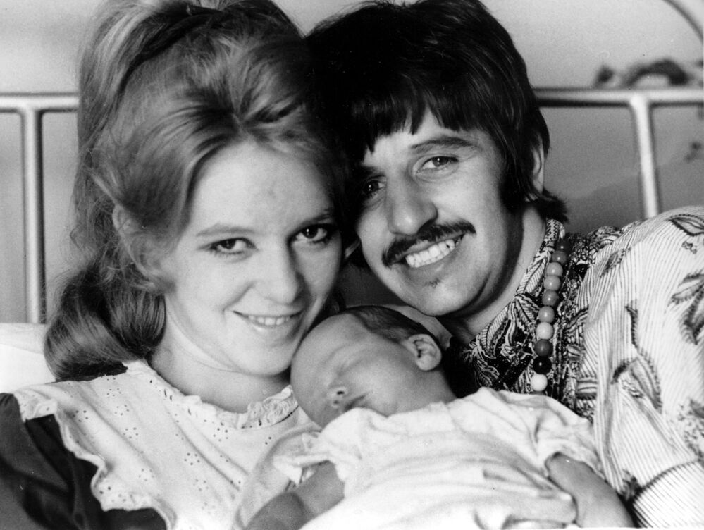 Member of The Beatles Ringo Starr and his first wife, Maureen, 21, pose with their son, Jason Starkey