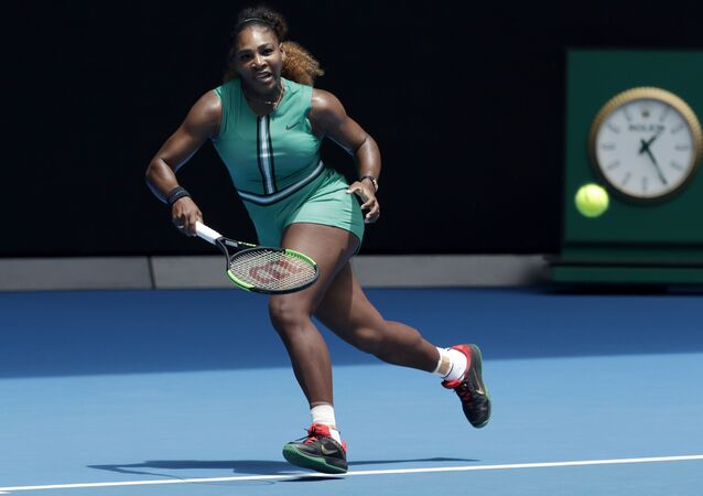 United States' Serena Williams prepares to hit a forehand return to Germany's Tatjana Maria during their first round match at the Australian Open tennis championships in Melbourne, Australia, Tuesday, Jan. 15, 2019.