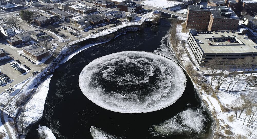 In this Monday, Jan. 14, 2019 aerial image taken from a drone video and provided by the City of Westbrook, Maine, a naturally occurring ice disk forms on the Presumpscot River in Westbrook, Maine.