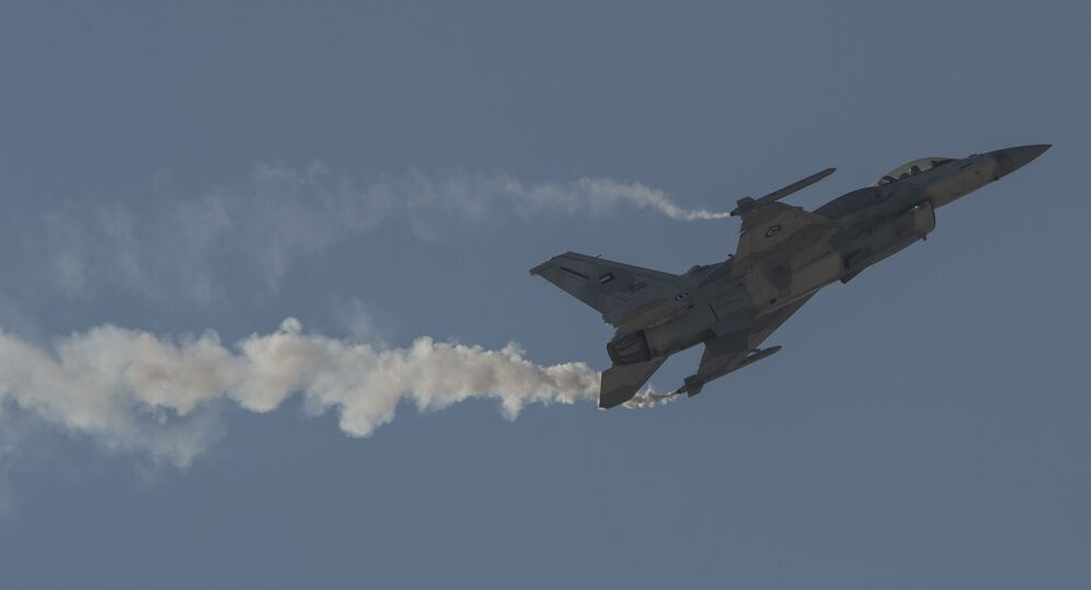 An F-16 Desert Falcon of the United Arab Emirates maneuvers at the Bahrain International Airshow in 2016.