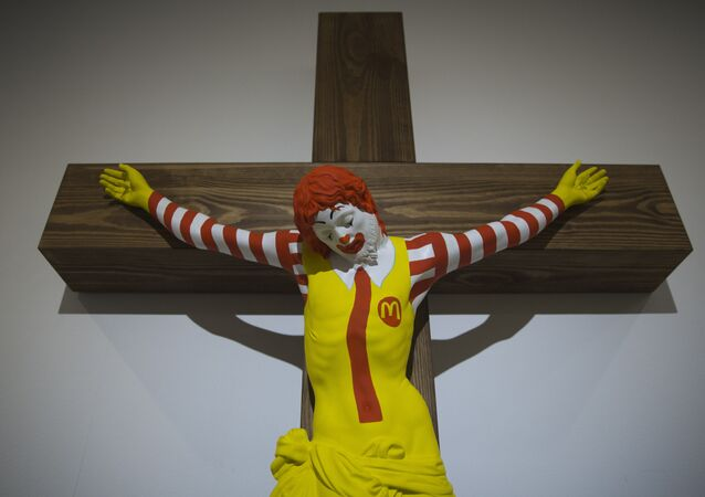 An artwork called McJesus, which was sculpted by Finnish artist Jani Leinonen and depicts a crucified Ronald McDonald, is seen on display as part of the Haifa museum's Sacred Goods exhibit, in Haifa, Israel, Monday, Jan. 14, 2019