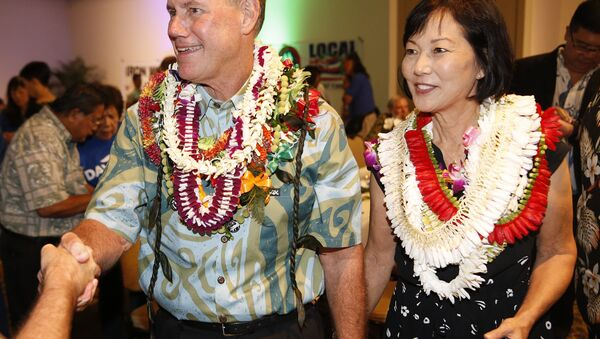 Rep. elect Ed Case, D-Hawaii, right, and his wife Audrey Nakamura Case, greet supporters Tuesday, Nov. 6, 2018, in Honolulu - Sputnik International