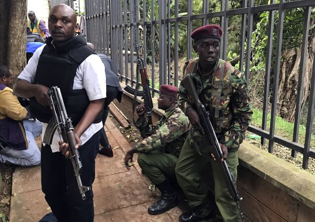 Security forces are seen at the scene of a blast in Nairobi, Tuesday, Jan. 15, 2019