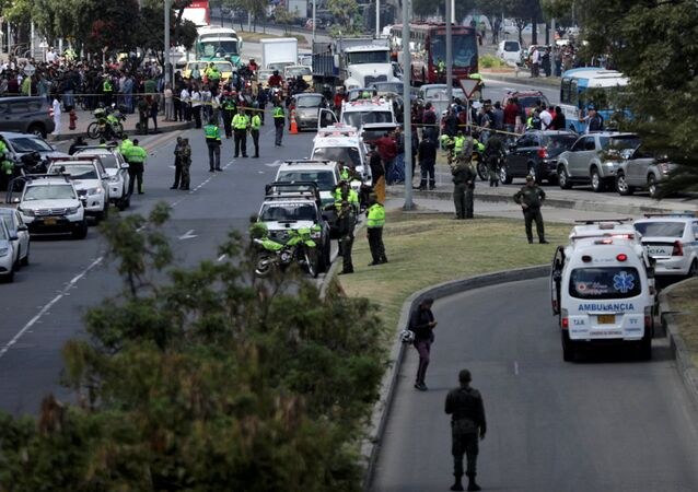 Police and security personnel work at the scene where a car bomb exploded, according to authorities, in Bogota, Colombia January 17, 2019