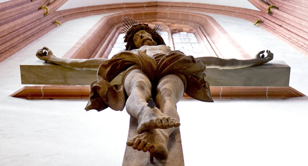 A crucifix is attached to the wall of the Cathedral in Frankfurt, Germany, Tuesday, Sept. 25, 2018