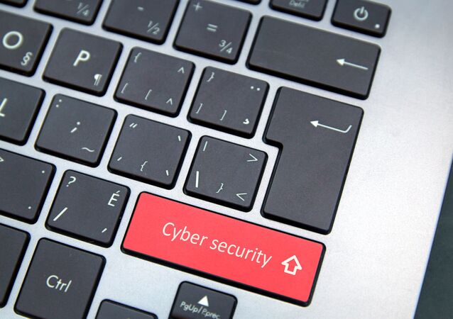 Computer keyboard with red cybersecurity button