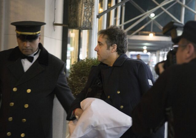Michael Cohen arrives at his home in New York with his left arm in a sling supported by a pillow Friday, Jan. 18, 2019.