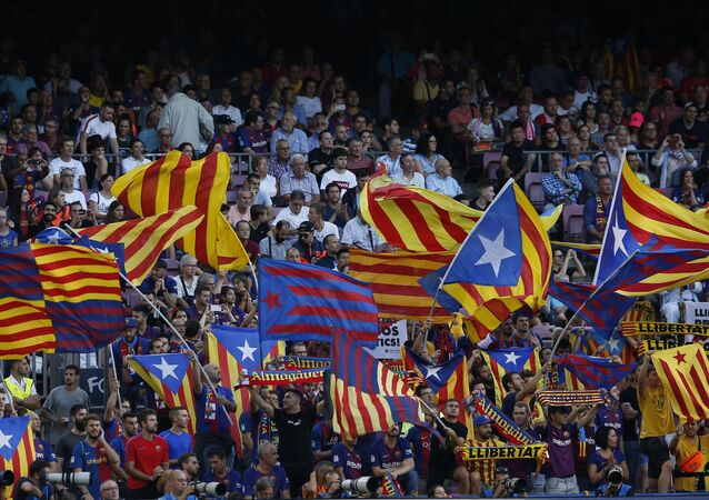 Barcelona fans cheer for their team before the group B Champions League soccer match between FC Barcelona and PSV Eindhoven at the Camp Nou stadium in Barcelona, Spain, Tuesday, Sept. 18, 2018