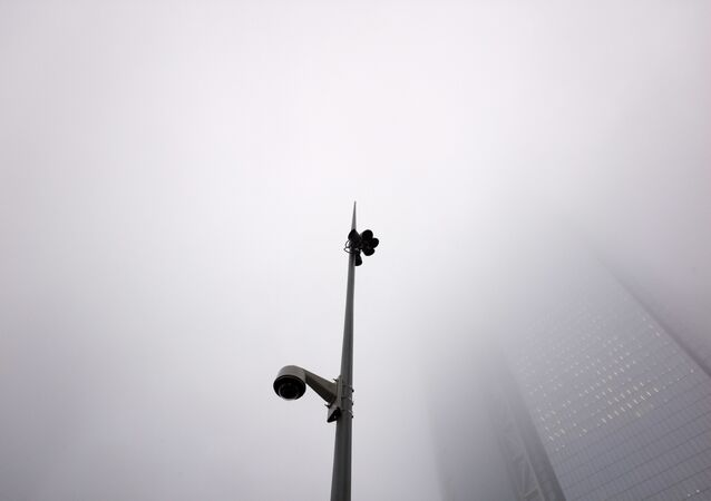 A fog hangs above a light pole with a surveillance camera at the World Trade Center, Tuesday, Feb. 20, 2018, in New York
