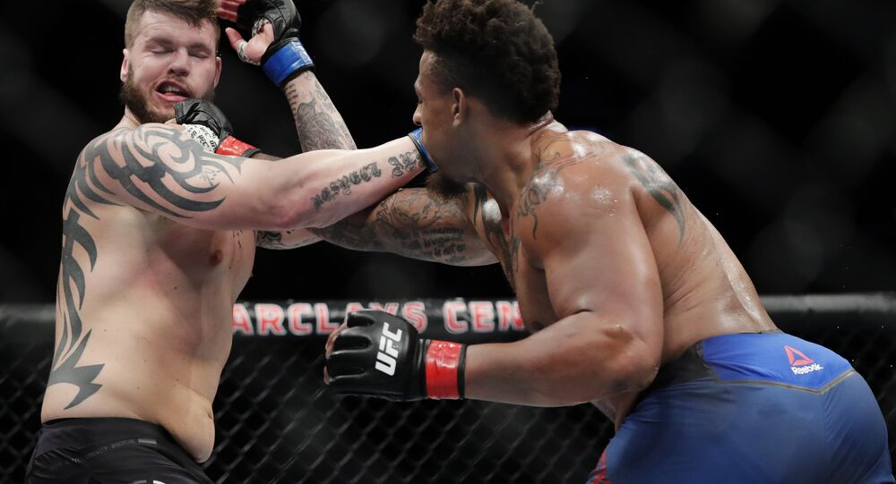 Greg Hardy, right, punches Allen Crowder during the second round of a heavyweight mixed martial arts bout at UFC Fight Night on Saturday, Jan. 19, 2019, in New York