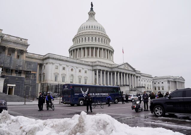 A U.S. Air Force bus meant to transport U.S. Speaker of the House Nancy Pelosi and other members of a congressional delegation to a flight to Belgium and Afghanistan sits guarded by U.S. Capitol Police in front of the Capitol after President Donald Trump cancelled the Air Force flight as the president's dispute with congressional Democrats over the partial government shutdown continues in Washington, U.S., January 17, 2019