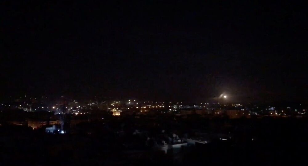 What is believed to be guided missiles are seen in the sky during what is reported to be an attack in Damascus, Syria, January 21, 2019, in this still image taken from a video obtained from social media