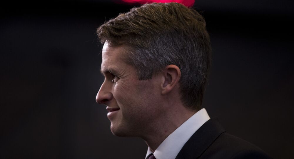 Britain's Defence Minister Gavin Williamson stands in the main chamber during the second day of a meeting of the North Atlantic Council at a gathering of NATO defence ministers at NATO headquarters in Brussels, Thursday, Oct. 4, 2018.