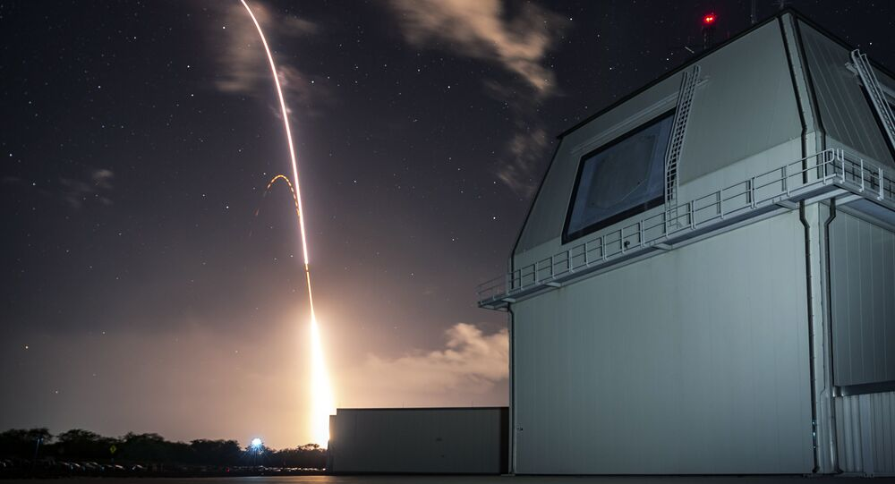 FILE - This Monday, Dec. 10, 2018, file photo provided by the U.S. Missile Defense Agency (MDA) shows the launch of the U.S. military's land-based Aegis missile defense testing system, that later intercepted an intermediate range ballistic missile, from the Pacific Missile Range Facility on the island of Kauai in Hawaii