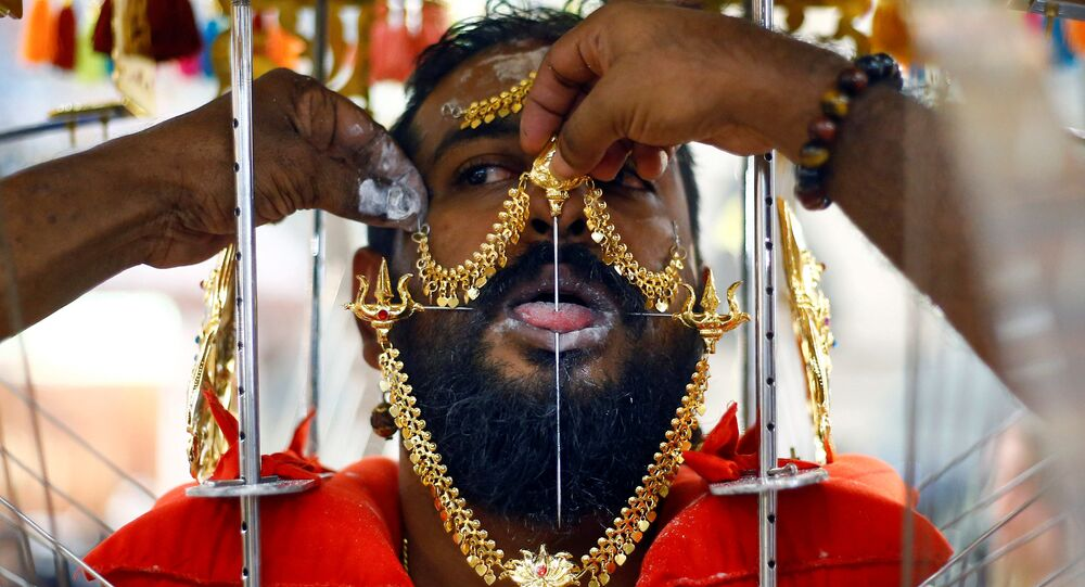 A devotee has his tongue pierced during the Thaipusam festival in Singapore, January 21, 2019