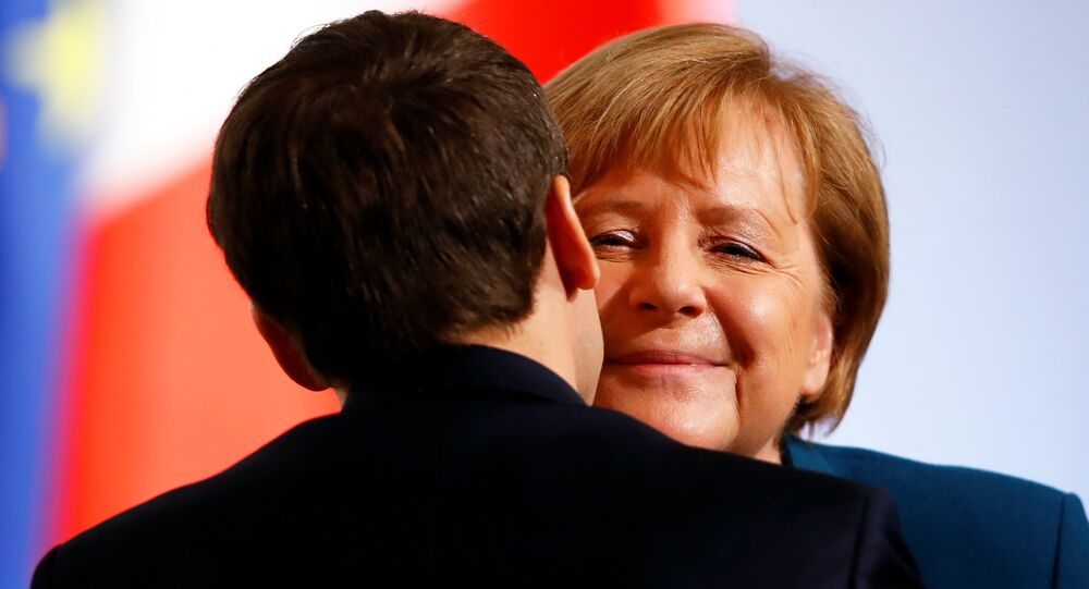 German Chancellor Angela Merkel and French President Emmanuel Macron attend a signing of a new agreement on bilateral cooperation and integration, known as Treaty of Aachen, in Aachen, Germany, January 22, 2019