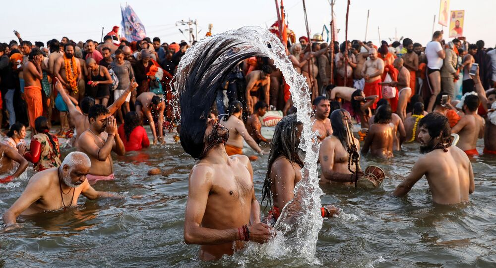Naga Sadhus or Hindu holy men take a dip during the first Shahi Snan (grand bath) at Kumbh Mela or the Pitcher Festival, in Prayagraj, previously known as Allahabad, India, January 15, 2019