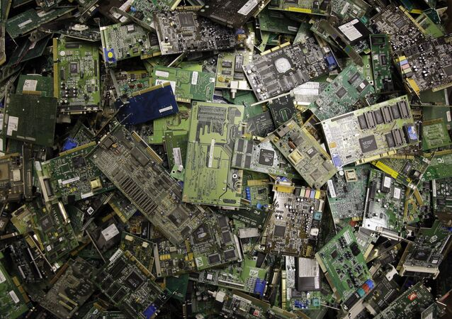 Circuit boards fill a bin at a recycling centre