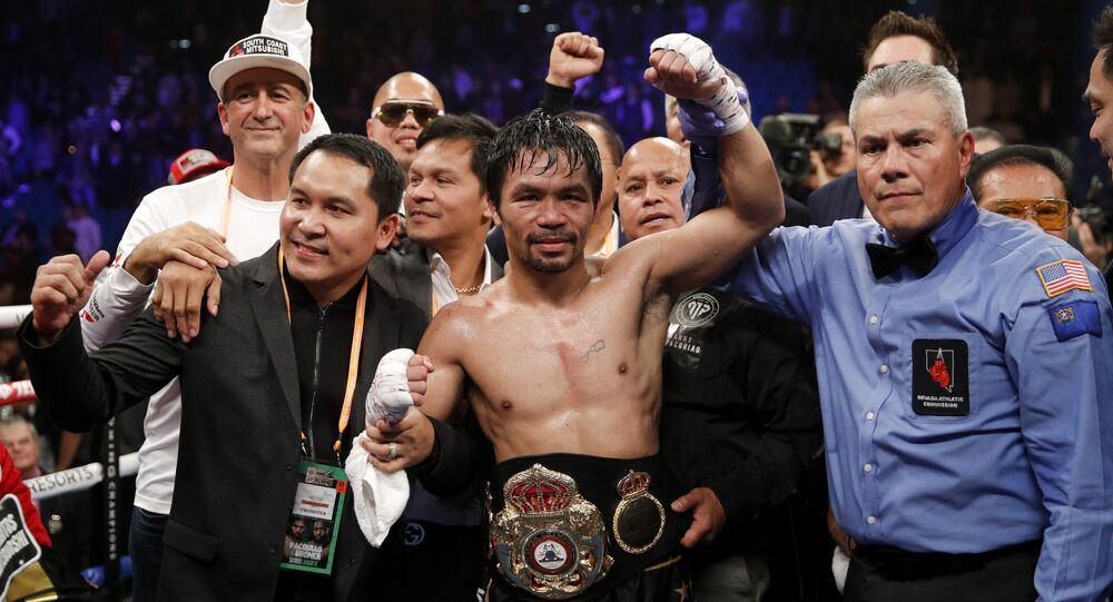Manny Pacquiao's hand is raised after he retained the WBA world welterweight title on 19 January 2019